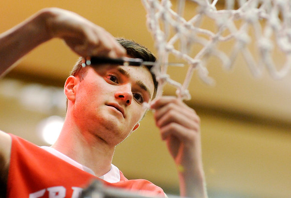 Don Knight | The Herald Bulletin<br /> Frankton's Keegan Freestone cuts down a piece of the net after the Eagles beat Marquette Catholic to win semi-state at Lafayette Jeff on Saturday.