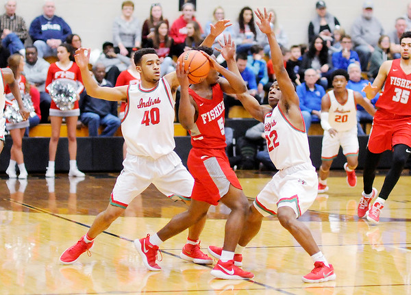 Don Knight | The Herald Bulletin<br /> Anderson's Brandon Haralson and Keyounis Woods double team Fishers Willie Jackson during the sectional semi-final at Noblesville on Friday.