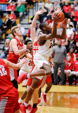 Don Knight | The Herald Bulletin<br /> Anderson's JoMel Boyd drives into the lane against Fishers during the sectional semi-final at Noblesville on Friday.