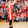 Don Knight | The Herald Bulletin<br /> Frankton's Andrew Hartley sinks a three to tie the game at 38 as the Eagles faced Wapahani in the Class 2A Sectional 40 final at Elwood on Saturday.