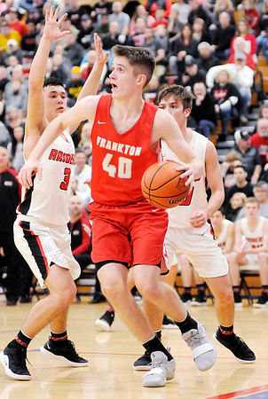 Don Knight   The Herald Bulletin<br /> Frankton's Rylan Detling drives the baseline as the Eagles faced Wapahani in the Class 2A Sectional 40 final at Elwood on Saturday.