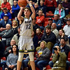 Andrew Bennett lines up a shot for Shenandoah during the fourth quarter in the IHSAA 2A Boys Basketball Sectional 42 final at Knightstown on Saturday. Shenandoah defeated Indianapolis Howe 66-50 to win the championship. Richard Sitler photo