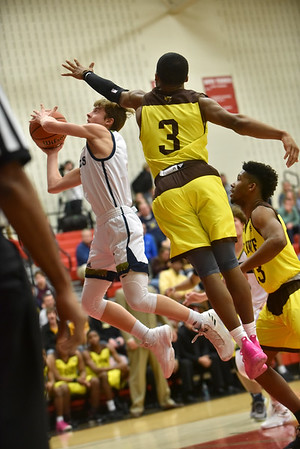 After putting a spin move on Howe defender Jalen Stamps, Shenandoah's Jakeb Kinsey takes the ball to the basket during the second quarter in the IHSAA 2A Boys Basketball Sectional 42 final at Knightstown on Saturday. Shenandoah defeated Indianapolis Howe 66-50 to win the championship. Richard Sitler photo