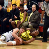 Shenandoah's Kaden McCollough and Howe's Kycia Washington vye for a loose ball on the floor during the third quarter in the IHSAA 2A Boys Basketball Sectional 42 final at Knightstown on Saturday. Shenandoah defeated Indianapolis Howe 66-50 to win the championship. Richard Sitler photo