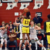 Howe's Creshawn Brown attempts a shot over Shenandoah defender Evan Coers during the second quarter in the IHSAA 2A Boys Basketball Sectional 42 final at Knightstown on Saturday. Shenandoah defeated Indianapolis Howe 66-50 to win the championship. Richard Sitler photo