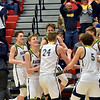 Shenandoah players and coaches celebrate as the defeated Indianapolis Howe 66-50 to win the 2A sectional 42 championship on Saturday at Knightstown. Richard Sitler photo
