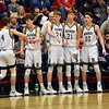 Shenandoah's Jakeb Kinsey receives recognition from the Raider bench as he is given a breather during the first half in the IHSAA 2A Boys Basketball Sectional 42 final at Knightstown on Saturday. Shenandoah defeated Indianapolis Howe 66-50 to win the championship. Richard Sitler photo