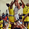 Shenandoah's Andrew Bennett runs into a crowd of Howe defenders as he drives into the lane during the second quarter in the IHSAA 2A Boys Basketball Sectional 42 final at Knightstown on Saturday. Shenandoah defeated Indianapolis Howe 66-50 to win the championship. Richard Sitler photo