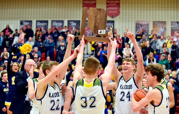 Richard Sitler | For The Herald Bulletin<br /> Shenandoah players hold up the chapmpionship trophy for the IHSAA 2A Boys Basketball Sectional 42. Shenandoah defeated Indianapolis Howe 66-50 in the final at Knightstown on Saturday.