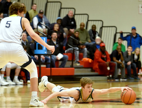 Shenandoah's Jakeb Kinsey reaches for a loose ball as he tries to regain possession after loosing it during the second quarter in the IHSAA 2A Boys Basketball Sectional 42 final at Knightstown on Saturday. Shenandoah defeated Indianapolis Howe 66-50 to win the championship. Richard Sitler photo