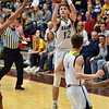 Andrew Bennett attempts a shot from behind the arc for Shenandoah during the first quarter in the IHSAA 2A Boys Basketball Sectional 42 final at Knightstown on Saturday. Shenandoah defeated Indianapolis Howe 66-50 to win the championship. Richard Sitler photo