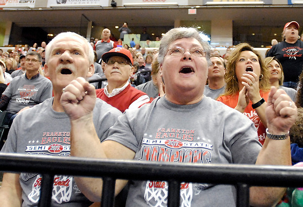 John P. Cleary |  The Herald Bulletin<br /> Keith and Connie Moore watch the Frankton game with anticipation as they react to the action on the court. They are the grandparents of Frankton senior player Maurice Knight.