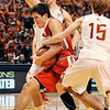 John P. Cleary |  The Herald Bulletin<br /> Frankton's Kayden Key drives between Crawford County's Tyrell Nickelson and Christian Carlton, right, as Carlton gets a hand on the ball during the IHSAA 2A Boys Basketball state finals Saturday.