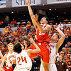 John P. Cleary |  The Herald Bulletin<br /> Frankton's Maurice Knight goes up for 2 of his game-high 23 points against Crawford County's Noah Sturgeon and Matt Dearborn in the IHSAA 2A Boys Basketball state finals Saturday March 25, 2017. The Frankton Eagles defeated the Wolfpack 60-32.