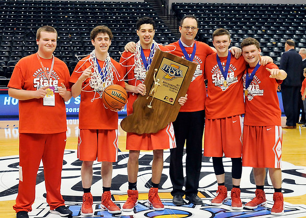 John P. Cleary |  The Herald Bulletin<br /> Frankton coach Brent Brobston with the seniors on the team.