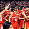 John P. Cleary |  The Herald Bulletin<br /> Frankton players celebrate together after winning the 2A state basketball title.