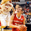 John P. Cleary |  The Herald Bulletin<br /> Frankton's Travis McGuire, right, looks toward the basket as Crawford County's Noah Sturgeon defends by fouling him on the play during the IHSAA 2A Boys Basketball state finals Saturday.