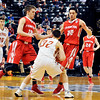 John P. Cleary |  The Herald Bulletin<br /> Frankton's Landon Weins and Maurice Knight put pressure on Crawford County's Tyrell Nickelson as he brings the ball up court.