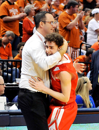 John P. Cleary |  The Herald Bulletin<br /> Frankton Eagles head coach Brent Brobston gives his senior guard Patrick Spillman a hug as he takes him out at the end of the IHSAA 2A Boys Basketball state finals game against Crawford County. The Frankton Eagles defeated the Wolfpack 60-32.