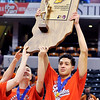 John P. Cleary |  The Herald Bulletin<br /> Frankton's seniors Cole Garner and Maurice Knight lift up the 2A State Championship trophy after defeating Crawford County 60-32.