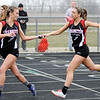 Don Knight | The Herald Bulletin<br /> Frankton's Kayla Quimby takes the baton from Rachael LeMaster as Frankton's girls win the 1600 meter relay on Wednesday. Also on the Ealges relay team were Meadow Kerrigan and Audrey Maupin.