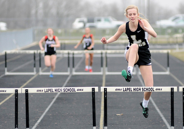 Don Knight | The Herald Bulletin<br /> Lapel's Paige Rich wins the 300 meter hurdles as the Bulldogs hosted the Frankton Eagles for a track meet on Wednesday.