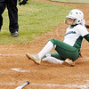 Don Knight | The Herald Bulletin<br /> Pendleton Heights' Chloe Chlosser slides into home after being batted in by Grace Scott as the Arabians hosted the Center Grove Trojans on Friday.
