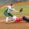 Don Knight   The Herald Bulletin<br /> Pendleton Heights' Grace Scott brings down the tag as Center Grove's Piper Belden slides between her legs on Friday.