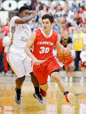 Don Knight | The Herald Bulletin<br /> Frankton's Kayden Key drives as he is guarded by Monroe Central's Maurice Richardson during the sectional semi-final at Lapel on Friday.