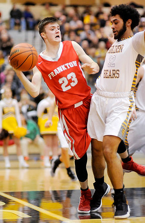 Don Knight | The Herald Bulletin<br /> Frankton's Keegan Freestone draws a foul from Monroe Central's Jalen Clay during the sectional semi-final at Lapel on Friday.