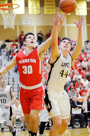 Don Knight | The Herald Bulletin<br /> Frankton's Kayden Key and Lapel's Luke Richardson reach for the ball as the Eagles and Bulldogs played in the sectional final on Saturday.