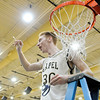 Don Knight | The Herald Bulletin<br /> Lapel's Austin Lyons holds up a piece of the net after the Bulldogs beat the Frankton Eagles for the sectional championship on Saturday.