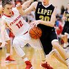 Don Knight | The Herald Bulletin<br /> Frankton's Landon Weins picks up a foul as he collides with Lapel's Austin Lyons during the 2A sectional championship at Lapel on Saturday.
