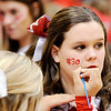 Don Knight | The Herald Bulletin<br /> Frankton cheerleader Amanda Rayot paints a 30 on Karsyn Litsey's cheek before the sectional championship at Lapel on Saturday.