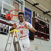 Chris Martin for The Herald Bulletin.  Liberty Christian's Ronnie Williams cuts down the net Saturday night at Wes-Del.  Liberty Christian defeated Wes-Del to win the Class 1A Sectioanl 55 Championship.