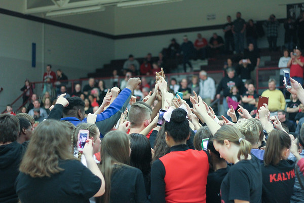 Chris Martin for The Herald Bulletin.  Liberty Christian players and students celebrate the Class 1A Sectional Championship at mid court Saturday Night at Wes-Del.