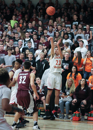 Chris Martin for The Herald Bulletin.  Liberty Christian's Joshua Tufts takes a 3 pointer against Wes-Del Saturday night in the Class 1A Sectional 55 Final at Wes-Del.