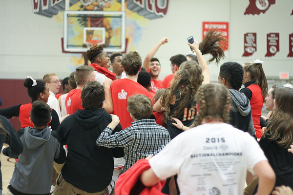 Chris Martin for The Herald Bulletin.  Liberty Christian students storm the court to celebrate with players Saturday night.  Liberty Christian defeated Wes-Del to win the Class 1A Sectional 55 championship.