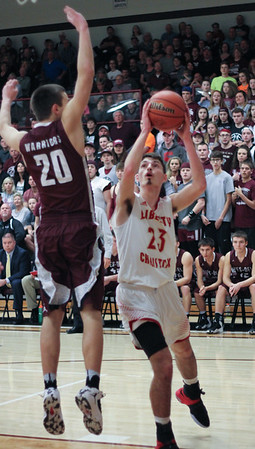 Chris Martin for The Herald Bulletin.  Liberty Christian's Joshua Tufts drives the lane against Wes-Del Saturday night in the Class 1A Sectional 55 Final at Wes-Del.