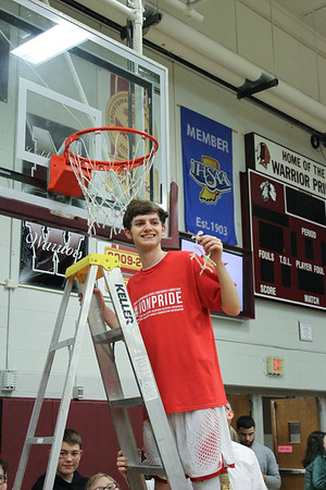 Chris Martin for The Herald Bulletin.  Liberty Christian's Isaiah Brees cuts down the net Saturday night at Wes-Del.  Liberty Christian defeated Wes-Del to win the Class 1A Sectioanl 55 Championship.