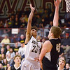 Daleville's Trevion Johnson shoots over the outstretched arm of Cowan's Riley Duncan in the sectional final at Wes-Del on Saturday.