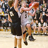 Daleville's Connor Fleming drives to the basket as he is guarded by Cowan's Simon Underwood in the sectional final at Wes-Del on Saturday.