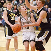 Daleville's Tim Arnold looks to shoot as he is guarded by Cowan's Riley Duncan in the sectional final at Wes-Del on Saturday.