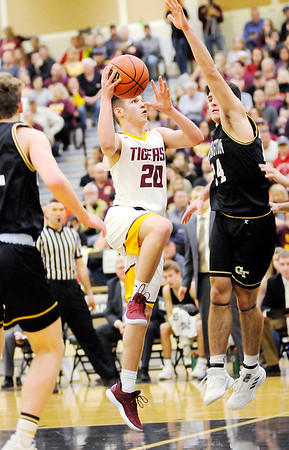 Don Knight | The Herald Bulletin<br /> Alexandria's Brennan Morehead drives into the paint for a basket as the Tigers faced Covington in the first round of the regional at Lapel on Saturday.