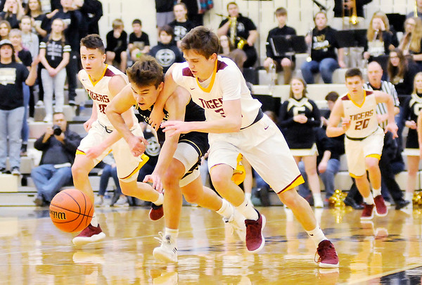 Don Knight | The Herald Bulletin<br /> Alexandria's Sam Hensley and Covington's Ty Bever chase down a loose ball in the first round of the regional at Lapel on Saturday.