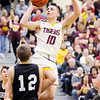 Don Knight | The Herald Bulletin<br /> Alexandria's Cade Vernetti draws a foul from Covington's Ethan Engle on a drive to the basket in the first round of the regional at Lapel on Saturday.