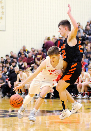 Don Knight | The Herald Bulletin<br /> Frankton's Ethan Bastes drives as he is guarded by Wabash's Trenton Daughtry in the first round of the regional at Lapel on Saturday.