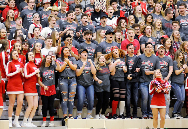 Don Knight | The Herald Bulletin<br /> Frankton's student section jumps on the bleachers before the tip as the Eagles faced Wabash in the first round of the regional at Lapel on Saturday.