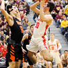 Don Knight | The Herald Bulletin<br /> Frankton's Kayden Key shoots as he is guarded by Wabash's Logan Vander Velden in the first round of the regional at Lapel on Saturday.