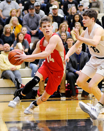 Don Knight | The Herald Bulletin<br /> Frankton's Ethan Bates drives the baseline as the Eagles faced Covington in the regional final at Lapel on Saturday.